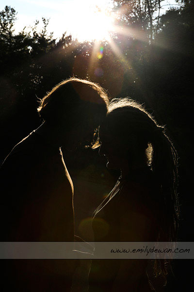 maine sun flare back lit couple